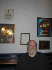 Steve Burgh with some of his awards